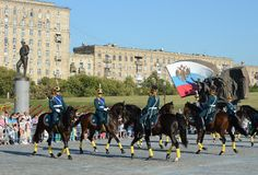 The cavalry honorary escort of the Presidential Regiment speaks against the background of the monument to the heroes of the First. MOSCOW, RUSSIA - AUGUST 22 Stock Image