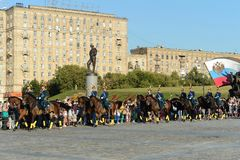 The cavalry honorary escort of the Presidential Regiment speaks against the background of the monument to the heroes of the First Royalty Free Stock Image