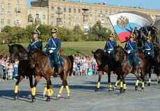 The cavalry honorary escort of the Presidential Regiment speaks against the background of the monument to the heroes of the First Stock Photography