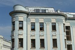 Four-storey residential building 1911, facing with the facades to Malaya Dmitrovka and Bolshoy Putinkovsky Lane in Moscow. MOSCOW, RUSSIA-AUGUST 20, 2018: Four stock photo