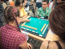 Moscow, Russia - August 09, 2018: Japanese festival in Moscow. Young people playing mahjong asian tile-based game. Table. Gambling side view stock photo