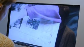 Woman using interactive touchscreen display at modern history museum stock footage