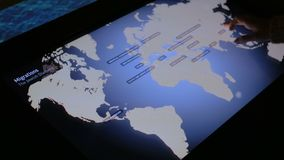 Woman using interactive touchscreen display at modern history museum stock video footage