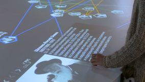 Woman using interactive touchscreen display at jewish history museum stock footage