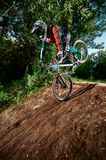 Mountain bike cyclist ridden on the front wheel. Moscow, Russia -  August 31, 2017: Mountain bike cyclist doing stoppie, ridden on the front wheel on a mtb bike Royalty Free Stock Photography