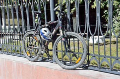 Moscow, Russia, August, 21,2016. Nobody, he bike is fastened to the fence with antigonos device Royalty Free Stock Photography