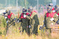 MOSCOW, RUSSIA - AUGUST, 2017: Paintball sport players in protective uniform and mask preparing for battle. MOSCOW, RUSSIA - AUGUST, 2017: Paintball sport Royalty Free Stock Photo