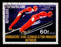 Karl Schnabl and Toni Innauer, Austria, ski jumping, Olympic Games in Innsbruck serie, circa 1976. MOSCOW, RUSSIA - AUGUST 29, 2017: A stamp printed in Central Royalty Free Stock Images