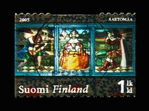 Stained glass window, Hvittrask serie, circa 2005. MOSCOW, RUSSIA - AUGUST 18, 2018: A stamp printed in Finland shows Stained glass window, Hvittrask serie royalty free stock photography