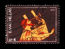 Ancient Guitarist, Musical Instruments serie, circa 1975. MOSCOW, RUSSIA - AUGUST 18, 2018: A stamp printed in Greece shows Ancient Guitarist, Musical royalty free stock photography