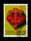 Artefacts from the Alps, Alpine Dairy farming implements serie, circa 1980. MOSCOW, RUSSIA - AUGUST 18, 2018: A stamp printed in Liechtenstein shows Artefacts stock image