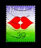 Kissing lips made of two hearts, Ten for Love serie, circa 2005. MOSCOW, RUSSIA - AUGUST 18, 2018: A stamp printed in Netherlands shows Kissing lips made of two stock image