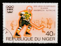 Ice Hockey, Olympic Games Innsbruck serie, circa 1976. MOSCOW, RUSSIA - AUGUST 29, 2017: A stamp printed in Niger shows Ice Hockey, Olympic Games Innsbruck serie Stock Photography