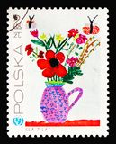 Flowers in vase, Children`s Drawings - 25th Anniversary of UNICEА. MOSCOW, RUSSIA - AUGUST 18, 2018: A stamp printed in Poland shows Flowers in vase, Children`s Stock Illustration