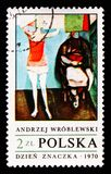 Woman hanging up laundry, by Andrzej Wroblewski, Paintings serie, circa 1970. MOSCOW, RUSSIA - AUGUST 18, 2018: A stamp printed in Poland shows Woman hanging up royalty free stock images