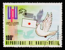 Emblem and dove carrying mail, circa 1974 Stock Images