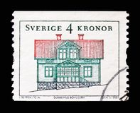 Double cottage, Bohuslan, Provincial Houses serie, circa 2003. MOSCOW, RUSSIA - AUGUST 18, 2018: A stamp printed in Sweden shows Double cottage, Bohuslan royalty free stock images