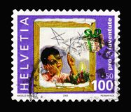 Boy wishing, Pro Juventute - Children's Rights serie, circa 2005. MOSCOW, RUSSIA - AUGUST 18, 2018: A stamp printed in Switzerland shows Boy wishing, Pro royalty free stock photo