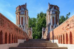 Moscow, Russia - August 12, 2018: Steps and towers of Figured bridge in Museum-reserve Tsaritsyno closeup on a blue sky background. In sunny summer morning royalty free stock photos