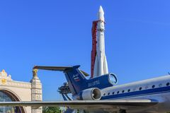 Moscow, Russia - August 01, 2018: Tail with engines and wing of soviet aircraft Yak-42 against Vostok booster rocket on Exhibition. Of Achievements of National stock photography