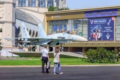 Moscow, Russia - August 01, 2018: Tourist walking near russian fighter SU-27 on Exhibition of Achievements of National Economy VD. NH in Moscow on a sunny summer stock images