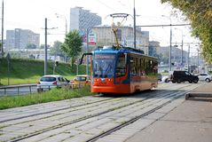 Moscow. Russia. August 23, 2016. The tram goes on rails along Prospekt Street of the world, transports passengers around the city. City public environmentally stock image