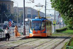 Moscow. Russia. August 23, 2016. The tram goes on rails along Prospekt Street of the world, transports passengers around the city. City public environmentally royalty free stock photography