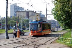Moscow. Russia. August 23, 2016. The tram goes on rails along Prospekt Street of the world, transports passengers around the city. City public environmentally stock photo