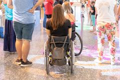 MOSCOW, RUSSIA - AUGUST 29, 2018: Two disabled persons in wheelchairs in the shopping mall stock image