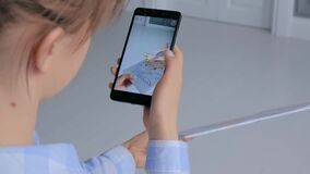 Woman using smartphone with AR application - virtual model of flying monoplane