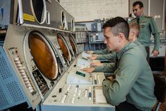 MOSCOW, RUSSIA - AUTUMN 2014: students of electronic technology institute learn to work with radars. MOSCOW, RUSSIA - AUTUMN 2014: students of the military royalty free stock photography