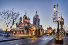 Festive New Year Lights at Varvarka Street in Twilight. MOSCOW, RUSSIA - Beautiful New Year and Christmas decorations in forms of giants candlesticks and royalty free stock images