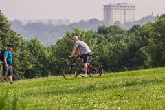 A biking down the hill in the park. Active lifestyle in the summer.
