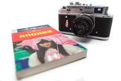 Vintage photo camera on the white background. Retro photo camera close up. 12.02.2018, Moscow, Russia. Concept of journey around Japan with vintage photo camera royalty free stock photo