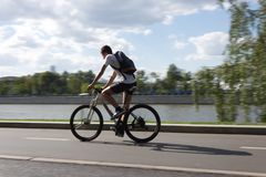 MOSCOW, RUSSIA - 06.20.2018: Cycle biker in Gorky Park moving on stock photos