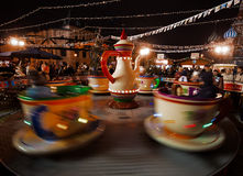 Moscow, Russia, december, 2015. Attraction cups of tea spinning in a circle. Royalty Free Stock Photography