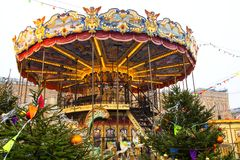 MOSCOW, RUSSIA - December, 2017 : Carousel in the center of Moscow, established in the framework of the Festival `Journey to Ch. MOSCOW, RUSSIA - December, 2017 stock photography