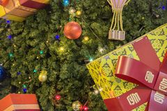 MOSCOW, RUSSIA - DECEMBER 06, 2017: Christmas tree decorated with colorful balls,garland and presents during. Fir tree background.  royalty free stock photo