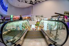 Shopping mall interior. Moscow, Russia - December 10, 2017: Cinema zone Kinomax in Columbus shopping mall interior with fisheye effect Royalty Free Stock Photo