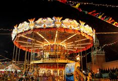 A colorful carousel at the New Year`s fair on Red Square in the center of Moscow in the evening Royalty Free Stock Photography