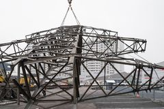 Moscow, Russia - December 21, 2017. The dismantling of the towers of high voltage lines in the city royalty free stock images
