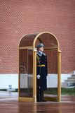 Guard near Tomb of Unknown soldier and Eternal flame in Alexander garden in Moscow Kremlin in Royalty Free Stock Photo