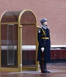 Guard near Tomb of Unknown soldier and Eternal flame in Alexander garden in Moscow Kremlin in Stock Photography