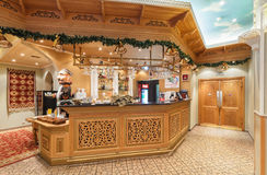 MOSCOW/RUSSIA - DECEMBER 2014. The interior of the deluxe restaurant of Uzbek cuisine - Babay Club in an oriental style. The woode Royalty Free Stock Images