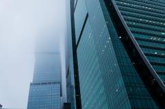 Modern skyscraper facade in the fog. MOSCOW, RUSSIA - DECEMBER 29, 2017 Modern skyscraper facade in the fog Stock Photography