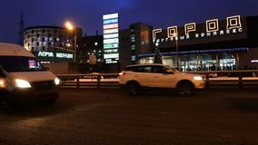 MOSCOW, RUSSIA,DECEMBER,27 .2018: Night traffic in the capital on the high-speed highway.Big city lights.Moscow, Ryazansky avenue. Central district stock video footage