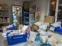 Post office is crowded with parcels from online stores before Christmas Royalty Free Stock Image