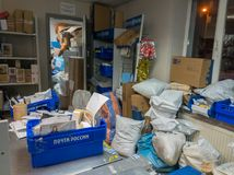 Post office is crowded with parcels from online stores before Christmas Stock Photo