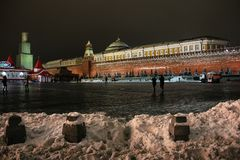 Moscow, Russia - December 2014: Reconstruction of Spasskaya Tower in scaffolding on Red Square in winter stock image