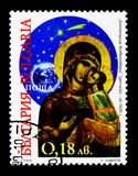 Mary with Child, Christmas: Icons serie, circa 1999. MOSCOW, RUSSIA - DECEMBER 21, 2017: A stamp printed in Bulgaria shows Mary with Child, Christmas: Icons Royalty Free Stock Image